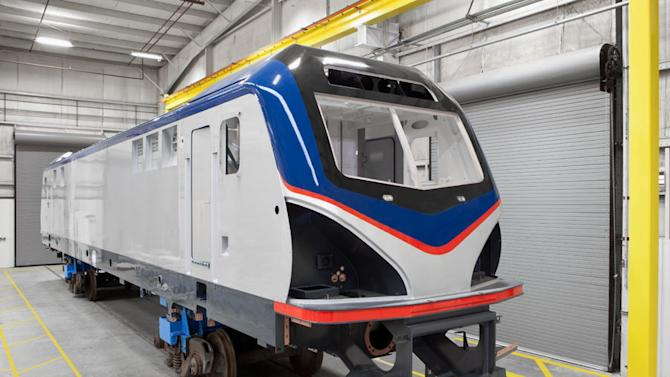 This undated handout photo provided by Amtrak shows the exterior of an electric Amtrak locomotive scheduled for delivery in 2013. Amtrak's fiscal 2012 operating loss was the lowest in nearly 38 years, which is a sign of progress, Joseph Boardman, the railroad's president and CEO, said Thursday. The $361 million loss for the year ending Sept. 30 was down 19 percent from the previous year. The last time Amtrak losses were less was 1975.  (AP Photo/Amtrak)
