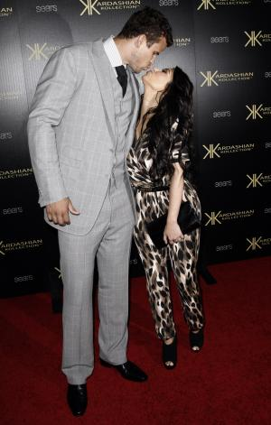 Kim Kardashian, right, and her fiance, NBA basketball player Kris Humphries, arrive at the Kardashian Kollection launch party in Los Angeles, Wednesday, Aug. 17, 2011. The Kardashian Kollection designed by the Kardashian sisters is available at Sears. (AP Photo/Matt Sayles)