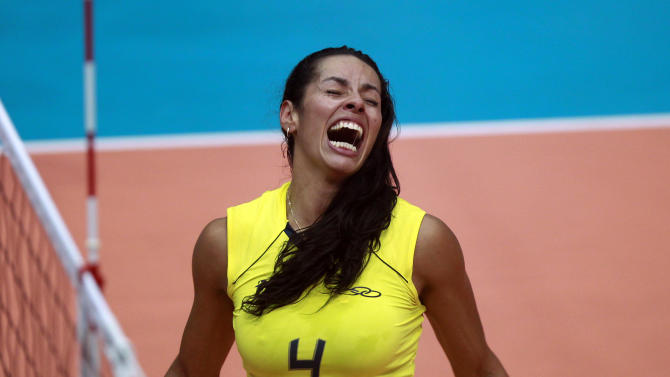 Brazil's Paula Pequeno celebrates after her team beat Cuba in the women's volleyball gold medal match during the Pan American Games in Guadalajara, Mexico, Thursday, Oct. 20, 2011. (AP Photo/Dario Lopez-Mills)