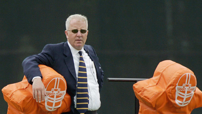 FILE - In this June 13, 2005, file photo,  Cleveland Browns owner Randy Lerner watches the team during NFL football camp in Berea, Ohio. Lerner has reached a deal to sell the team to Tennessee truck-stop magnate Jimmy Haslam III, according to multiple reports on Thursday, Aug. 2, 2012  ESPN and the NFL Network said Thursday that an agreement on the team sale had been reached. ESPN said the sale price was for more than $1 billion.  (AP Photo/Mark Duncan, File)