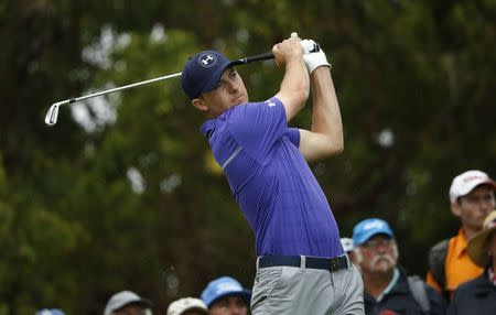 Spieth of the United States tees off on the fourth hole during the first round of the Australian Open golf tournament in Sydney
