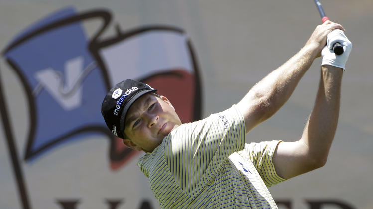 Hunter Haas watches his drive on the 18th hole during the first round of the Texas Open golf tournament, Thursday, April 19, 2012, in San Antonio. Haas finished the round at 6-under-par.   (AP Photo/Eric Gay)