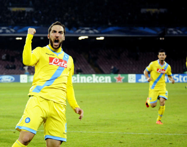Napoli's Gonzalo Higuain celebrates after scoring during a Champions League, group F, soccer match between Napoli and Arsenal, at the Naples San Paolo stadium, Italy, Wednesday, Dec. 11, 2013