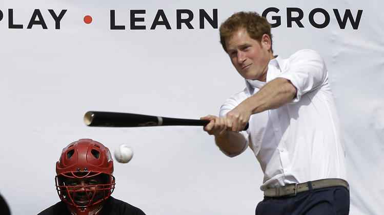 Britain's Prince Harry hits a ball pitched to him by New York Yankees first baseman Mark Teixeira during a visit to Harlem RBI's baseball program in New York, Tuesday, May 14, 2013, to launch a partnership between the organization, the Royal Foundation of the Duke and Duchess of Cambridge, and Prince Harry.  (AP Photo/Kathy Willens)