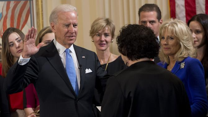 Vice President Joe Biden takes the oath of office during the 57th Presidential Inauguration official swearing-in ceremony at the Naval Observatory on Sunday, January 20, 2013 in Washington. The oath is administered by US Supreme Court Justice Sonia Sotomayor as Dr. Jill Biden, right, looks on. (AP Photo/Saul Loeb, Pool)