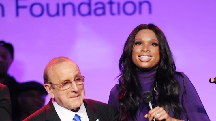 Clive Davis, left, and Jennifer Hudson appear onstage during the Multiple Myeloma Research Foundation at the 15th Anniversary Fall Gala supporting cancer research on Saturday, Oct. 27, 2012 in Greenwich, Conn. (Photo by Evan Agostini/Invision for MMRF/AP Images)