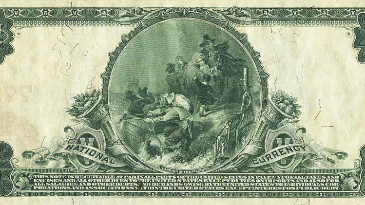 In this Sept. 2012 photo provided by Heritage Auctions, the back of a 1905 $5 bill is shown. How do you turn a $5 bill into $200,000? Let it sit around a century or so. A Dallas auctioneer is about to off a $5 bill presented in 1905 to Vice President Charles W. Fairbanks _ Theodore Roosevelt's No. 2 _ from the First National Bank of Fairbanks, Alaska. (AP Photo/Heritage Auctions)