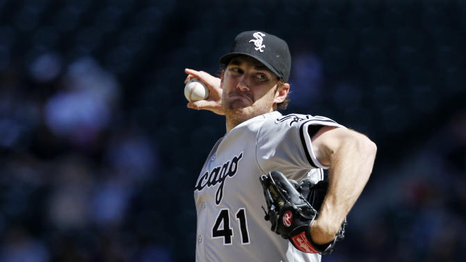 Chicago White Sox starting pitcher Phil Humber throws against the Seattle Mariners in the second inning in a baseball game Saturday, April 21, 2012, in Seattle. (AP Photo/Elaine Thompson)