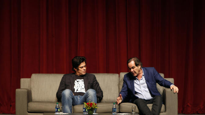 """Puerto Rican actor Benicio Del Toro, left, and film director Oliver Stone talk during a conference with students at the University of Puerto Rico in San Juan, Friday, Nov. 30, 2012. Del Toro didn't wait long to collect on a favor that Stone owed him for working extra hours on the set of his most recent movie, """"Savages"""", released this year: a trip to his native Puerto Rico, which Stone hadn't visited since the early 1960s.  Both are in the U.S. Caribbean territory to raise money for the Art Museum of Puerto Rico, which is hosting its annual movie festival and will honor Stone's movies. (AP Photo/Ricardo Arduengo)"""