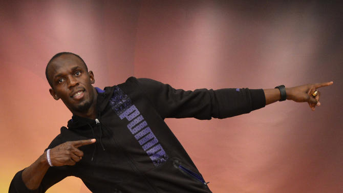 Jamaican athlete Usain Bolt gestures as he poses for photographers on the eve of the IAAF (International Association of Athletics Federations) Athlete of the Year Award marking the centenary of IAAF in Barcelona, Friday, Nov. 23, 2012. (AP Photo/Manu Fernandez)