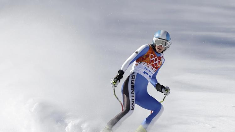 Argentina's Macarena Simari Birkner comes to a halt at the end of a women's downhill training run for the Sochi 2014 Winter Olympics, Friday, Feb. 7, 2014, in Krasnaya Polyana, Russia