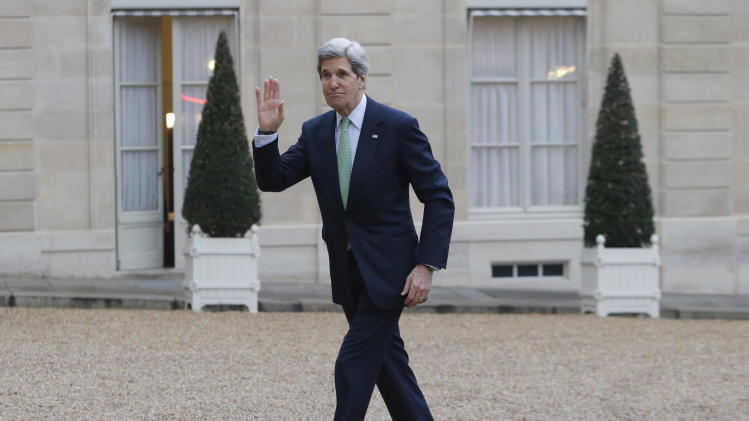 FILE - In this Feb. 27, 2013, file photo, U.S. Secretary of State John Kerry waves upon his arrival to meet France's President Francois Hollande at the Elysee Palace, in Paris. With the smile of a seasoned politician, a flair for languages and a vast repertoire of personal anecdotes, Kerry schmoozed and cajoled his way through Europe and the Middle East on his first trip abroad as America's top envoy over the past 10 days. (AP Photo/Francois Mori, File)