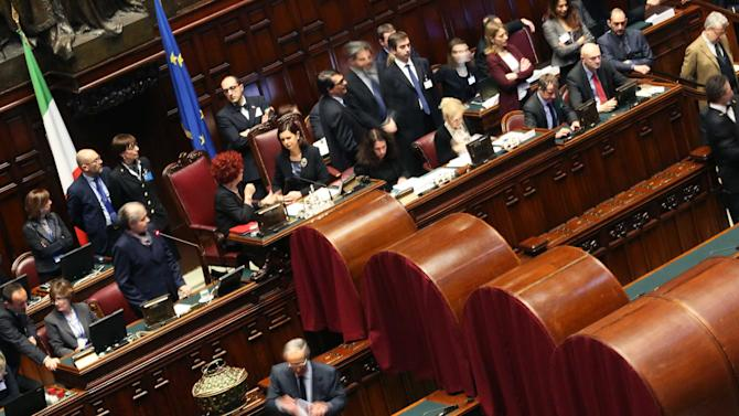 A member of parliament casts his vote at the Chambers of Deputies in Rome