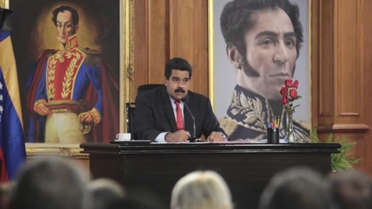 Venezuela's President Nicolas Maduro talks during a news conference at Miraflores Palace in Caracas