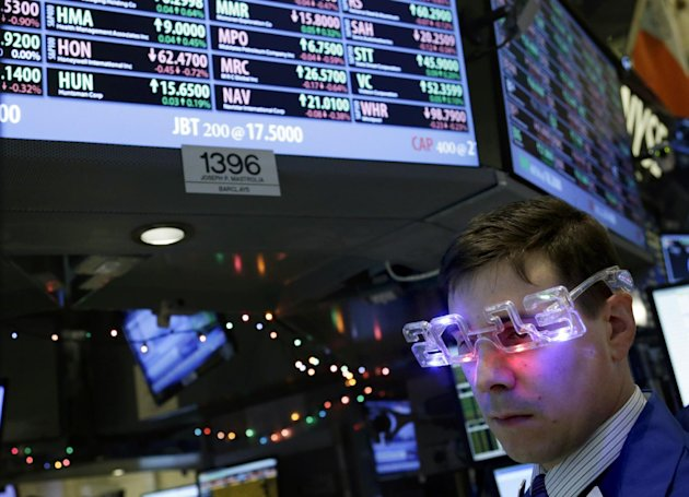 A trader wearing &quot;2013&quot; glasses works on the floor at the New York Stock Exchange in New York, Monday, Dec. 31, 2012. The stock market struggled for direction Monday morning after five days of losses, with the &quot;fiscal cliff&quot; just hours away and lawmakers yet to reach a solution. (AP Photo/Seth Wenig)