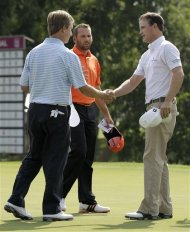 From left to right, David Toms and Spain's Sergio Garcia shake hands with Zach Johnson after playing their second round of the PGA Colonial golf tournament on Friday, May 25, 2012, in Fort Worth, Texas. (AP Photo/Tony Gutierrez)