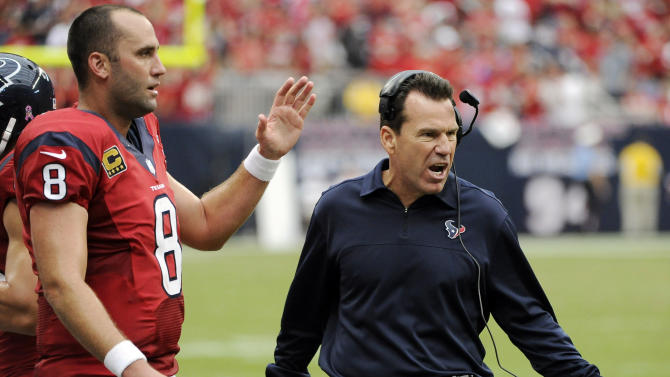 Houston Texans quarterback Matt Schaub and head coach Gary Kubiak celebrate Arian Foster's touchdown against the Baltimore Ravens during the third quarter of an NFL football game, Sunday, Oct. 21, 2012, in Houston. The Texans won 43-13. (AP Photo/Dave Einsel)