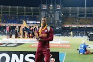 West Indies' Marlon Samuels holds the Man of The Match prize after victory in the ICC Twenty Cricket World Cup's final match against Sri Lanka, at the R. Premadasa International Cricket Stadium in Colombo, on October 7