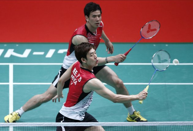 South Korea's Lee Yong-dae with partner Ko Sung-hyun plays a shot during their men's doubles match against Germany's Ingo Kindervater and Johannes Schoettler in Kuala Lumpur