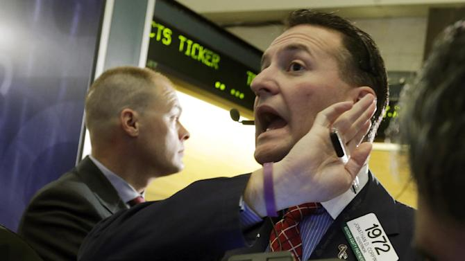Trader Jonathan Corpina, right, works on the floor of the New York Stock Exchange Thursday, Jan. 10, 2013. Stocks opened higher on Wall Street Thursday, gaining for a second day, after the European Central Bank chief said the region was poised to start growing again, bolstering expectations that the worst of the region's crisis is behind it. (AP Photo/Richard Drew)