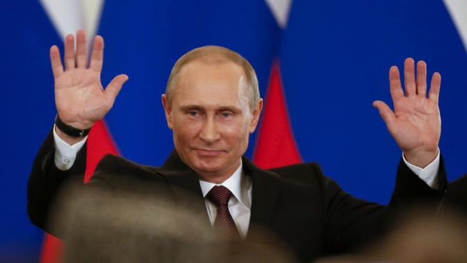 Russian President Vladimir Putin gestures after signing a treaty to incorporate Crimea into Russia in the Kremlin in Moscow, Tuesday, March 18, 2014. The crisis over Crimea is more than a dispute over whether the strategic Black Sea peninsula should be considered Russian or Ukrainian. At its root is a deeper issue: Russia's simmering anger over its treatment by the West since the 1991 breakup of the Soviet Union. Russia's biggest grievance has been the absorption into the NATO alliance not only of former Soviet allies, such as Poland and Romania, but also three republics that were part of the Soviet Union: Latvia, Lithuania and Estonia. The last straw was a European Union move to draw Ukraine closer to the West through a political association agreement. That set off a chain of events that led to the ouster of Ukraine's pro-Russian president and, ultimately, to Russia's annexation of Crimea. (AP Photo/Alexander Zemlianichenko)