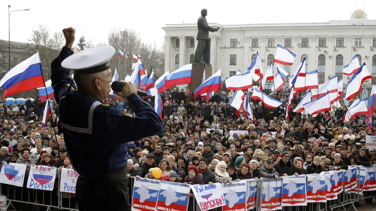Member of the Russian Song and Dance Ensemble of the Black Sea Fleet performs during a pro-Russian rally in Simferopol