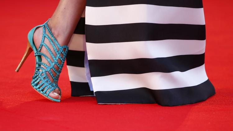 "A model attends the red carpet for the movie ""3 Coeurs"" (3 Hearts) at the 71st Venice Film Festival"