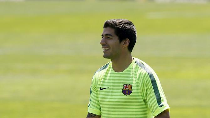 Barcelona's Luis Suarez attends a training session during the media Barcelona Open Day in Spain