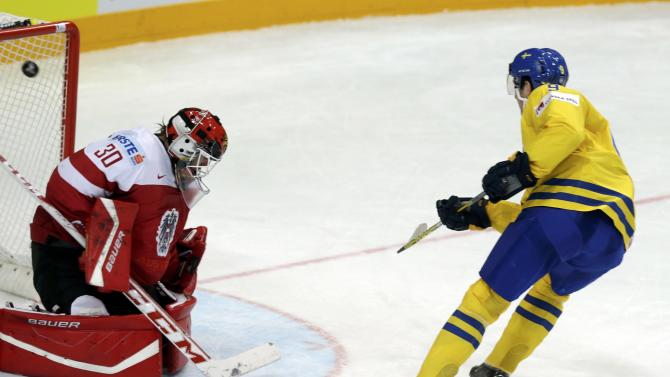 Sweden's Forsberg scores a goal past Austria's goaltender Swette during their Ice Hockey World Championship game at the O2 arena in Prague