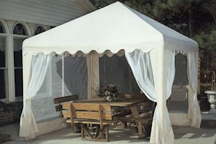 For outdoor summer weddings, shade is a must-have for guests and the food.