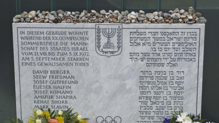 Wreaths and bouquets are placed at a memorial at the former accommodation building of the Israeli Olympic team in Munich, southern Germany, Wednesday, Sept. 5, 2012, during a commemoration ceremony for the assassination victims of the Olympic games in Munich in 1972. 17 people died in a failed liberation attempt of Israeli hostages, eleven of them of Israel's Olympic team, five terrorists and a German police officer. (AP Photo/dapd, Joerg Koch)