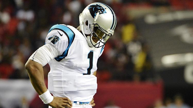 Carolina Panthers quarterback Cam Newton (1) reacts after losing a fumble during the second half of an NFL football game against the Atlanta Falcons, Sunday, Sept. 30, 2012, in Atlanta. The Falcons won 30-28. (AP Photo/Rich Addicks)