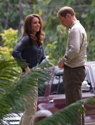 "Britain's Prince William and Catherine, the Duchess of Cambridge, arrive at the Borneo Rainforest Research Center in Danum Valley, on the island of Borneo on September 15. The British royal family have warned an Italian magazine that ""unjustifiable upset"" would be heaped on Catherine if it went ahead and printed topless photos of her"