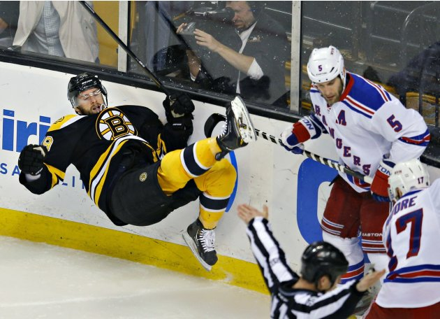 Boston Bruins Peverley is knocked over by New York Rangers Girardi during their NHL Eastern Conference semi-final in Boston