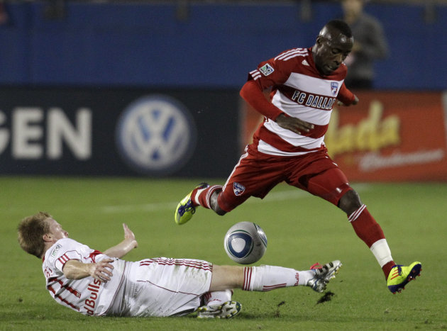 New York Red Bulls' Dax McCarty (11) clears the ball away from FC Dallas defender Jair Benitez in the first half of an MLS Cup first-round soccer match on Wednesday, Oct. 26, 2011, in Frisco, Texas. (