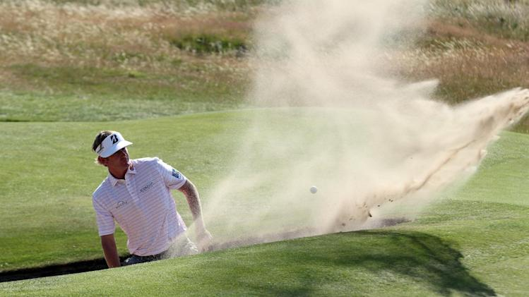 US golfer Brandt Snedeker plays out of a green-side bunker on the 15th hole during his first round 74, on the opening day of the 2014 British Open Golf Championship at Royal Liverpool Golf Course in Hoylake, England on July 17, 2014