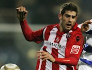 British police arrested nine people Tuesday for naming a woman raped by footballer Ched Evans, pictured in 2010, on social networking sites, bringing to 12 the number arrested over online circulation of the woman's name