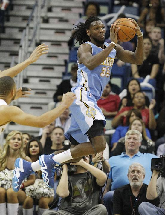 Denver Nuggets power forward Kenneth Faried (35) passes the ball late in the second half against the New Orleans Plicans in an NBA basketball game in New Orleans, Sunday, March 9, 2014.Faried was high
