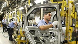 Employees work on the assembly line at the Renault plant in Sao Jose dos Pinhais
