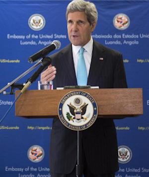 US Secretary of State John Kerry holds a media conference in Luanda, Angola, Monday, May 5, 2014. Kerry on May 4, praised oil-rich Angola's leadership role in efforts to solve long-drawn out conflicts on the African continent, and suggested the need to set a date for democratic elections. (AP Photo / Saul Loeb)