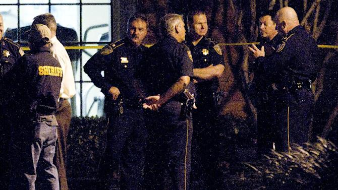 Law enforcement officers investigate the scene of a shooting Wednesday, Nov. 20, 2013, in Houston. Three people are dead and two have been airlifted to hospitals after gunfire erupted at a suburban Houston apartment complex Wednesday afternoon. (AP Photo/Houston Chronicle, Brett Coomer) MANDATORY CREDIT