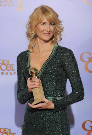 """FILE - In this Jan. 15, 2013 file photo, actress Laura Dern poses backstage with the award for Best Actress in a TV Series, Comedy or Musical for the TV series """" Enlightened"""" during the 69th Annual Golden Globe Awards, in Los Angeles. HBO says Dern's series """"Enlightened"""" isn't coming back for a third season. In a statement Tuesday, March 19, 2013, the premium cable channel said it was proud of the show, and called canceling it a """"very difficult decision.""""  (AP Photo/Mark J. Terrill, file)"""