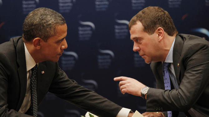 U.S. President Barack Obama, left,  chats with Russian President Dmitry Medvedev during a bilateral meeting at the Nuclear Security Summit in Seoul, South Korea, Monday, March, 26, 2012. (AP Photo/Pablo Martinez Monsivais)