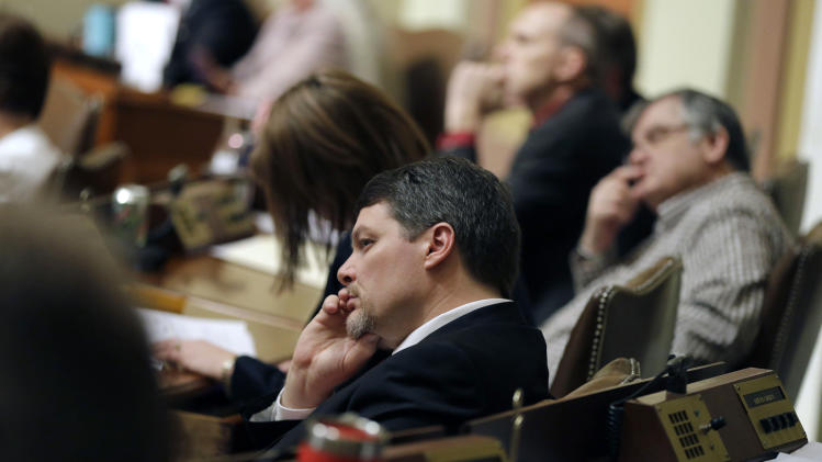 Rep. Jim Newberger listens to debate of the gay marriage bill in the Minnesota House, Thursday, May 9, 2013 in St. Paul, Minn. (AP Photo/Jim Mone)