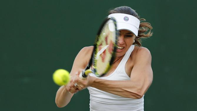 Hingis returns to Wimbledon but loses in doubles