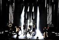 In this photo provided by Guy Oseary, Madonna performs on stage with dancers during her MDNA concert at Olympia Hall in Paris on Thursday, July 26, 2012. (AP Photo/Guy Oseary)