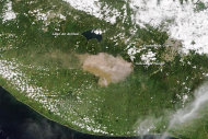 A picture taken by NASA&#39;s Terra satellite yesterday (Sept. 13) shows Guatemala&#39;s Fuego volcano spewing smoke and ash, which is being blown west from the volcano.