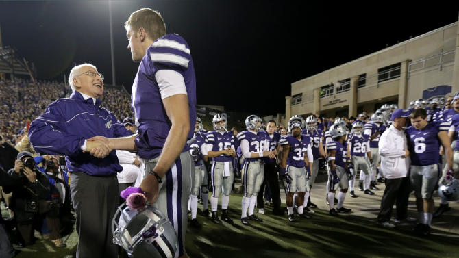 Kansas State coach Bill Snyder, left, talks to quarterback Collin Klein during a senior day recognition before an NCAA college football game against Texas, Saturday, Dec. 1, 2012, in Manhattan, Kan. (AP Photo/Charlie Riedel)