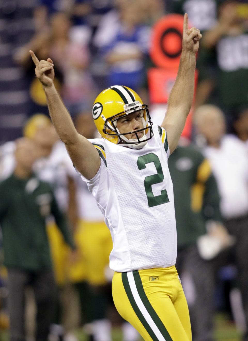 Green Bay Packers placekicker Mason Crosby celebrates his game-winning field goal as time expired the fourth quarter of an NFL preseason football game against the Indianapolis Colts in Indianapolis, Friday, Aug. 26, 2011. The Pacers defeated the Colts 24-21. (AP Photo/AJ Mast)