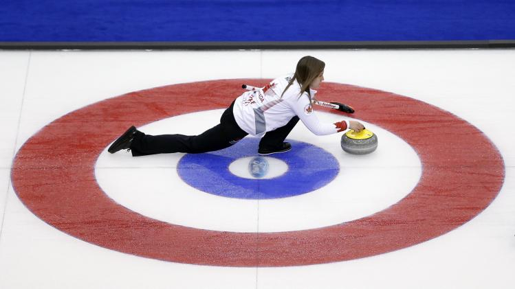 Canada skip Rachel Homan delivers a stone during her draw against Russia at the World Women's Curling Championships in St.John